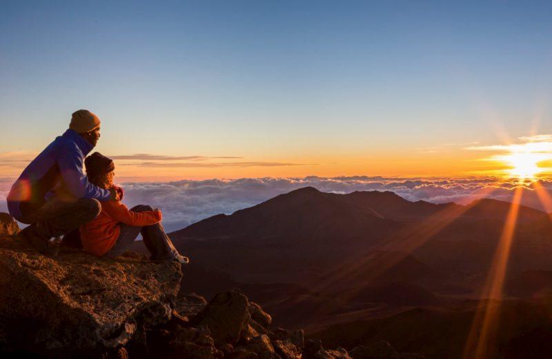 Couple watch the sun rise atop Haleakala
