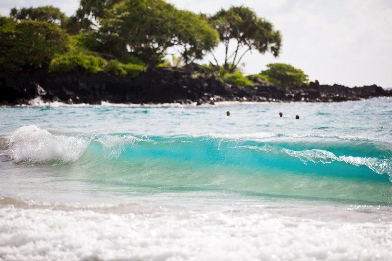 Wave crashing on shore of Hamoa Beach