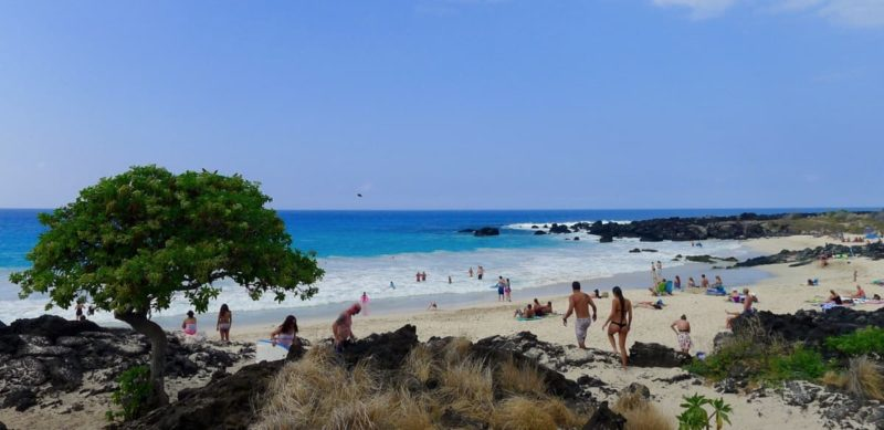 people on the beach of Kua Bay
