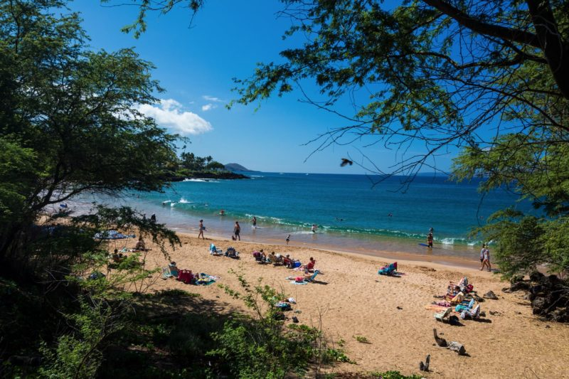 People enjoy a Makena Bay beach