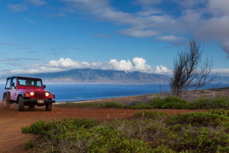Jeep drives along dirt road of North Lanai